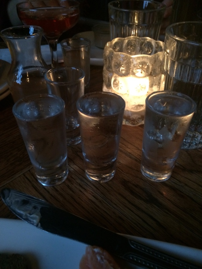 """PDX"" Flight of Vodkas from Kachka, backlit by a candle"