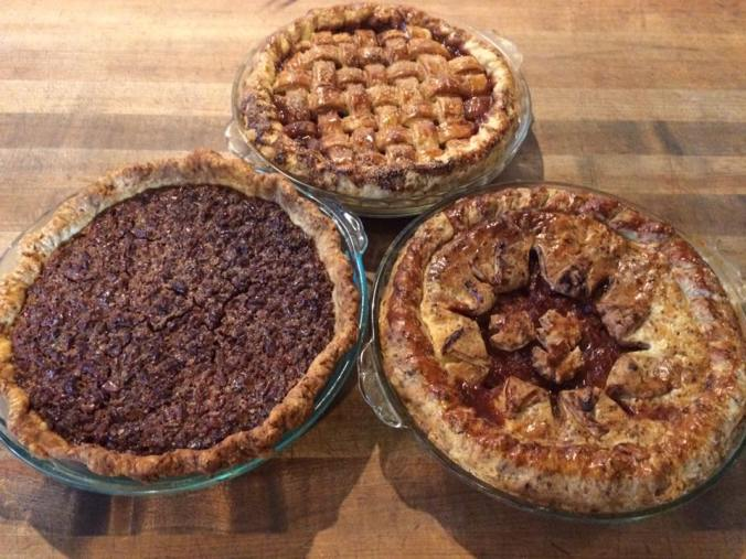 Picture of three pies, decorated differently.