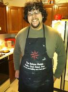 An old picture of the author, heavier with a black apron.