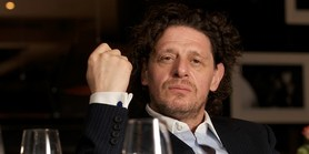 Chef Marco Pierre White raising a fist