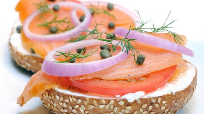 Sesame bagel with lox, cream cheese, capers, red onion, and dill