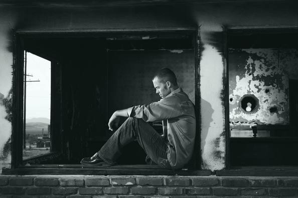 sad man thinking in a ruined apartment