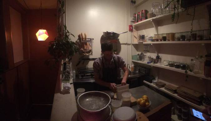 A young cook working in a small open kitchen