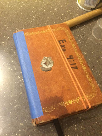 Small beaten-up recipe book
