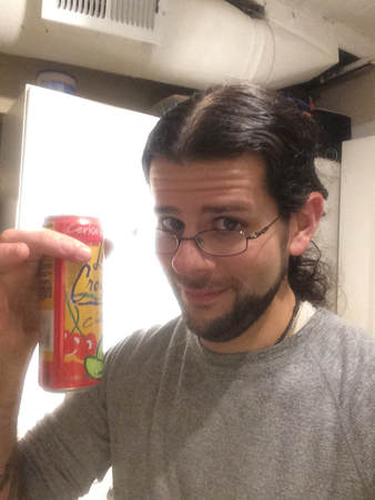 Me holding a can of fruity seltzer
