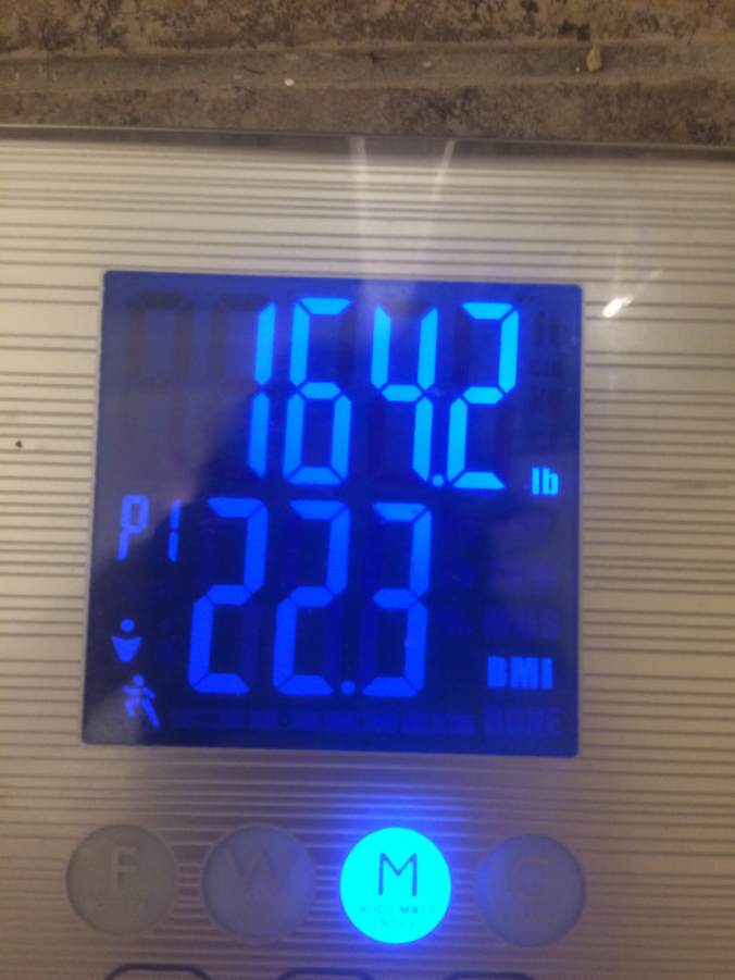Scale readout indicating 164.2 pounds and a BMI of 22.3