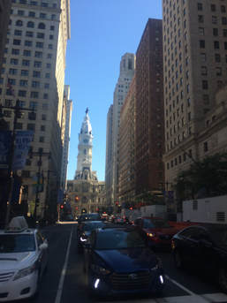 Street-level photo of Broad Street looking toward Philadelphia City Hall