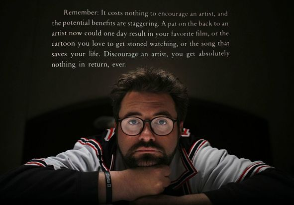 A picture of Kevin Smith with the quote,