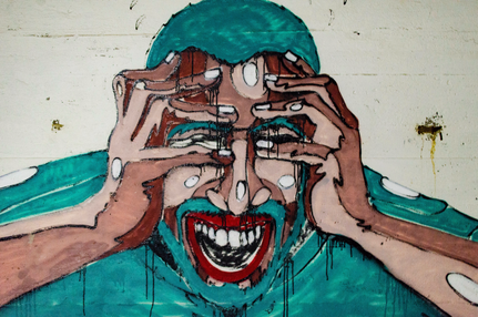 graffiti wall painting of a screaming man