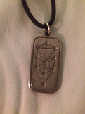 A pewter pendant depicting the sephirot in the Etz Chaim pattern.