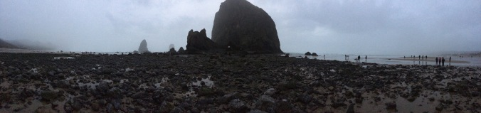 A panoramic shot of Cannon Beach and Haystack Rock in Oregon