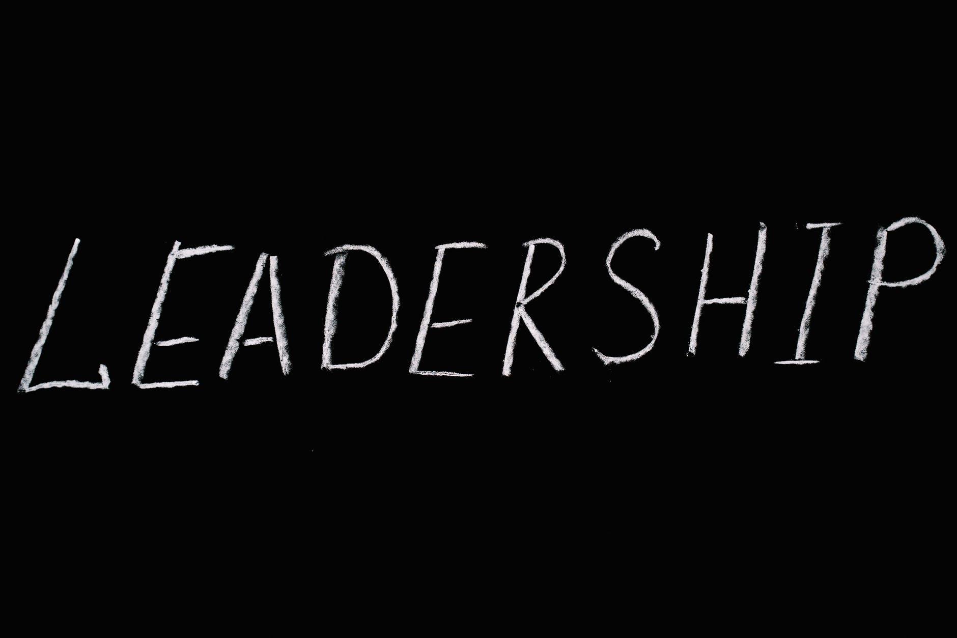 """Leadership"" written in chalk on a black background."